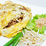 Fried noodle wrapped with eggs Stock Image