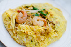 Fried noodle wrapped with eggs, Thai style food Royalty Free Stock Images