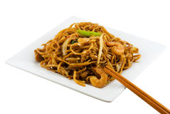 Fried Noodles 2. A plate of fried noodles and chopsticks isolated in solid white background stock photo