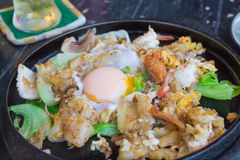 Fried Noodles with Chicken and Soft-boiled eggs Stock Photography