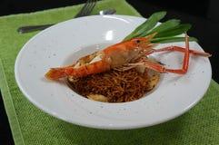Fried noodles with grilled shrimp Stock Image