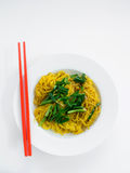 Fried noodles with red chopstick in white plate on white backgro Royalty Free Stock Images