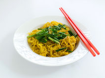 Fried noodles with red chopstick in white plate on white backgro Royalty Free Stock Photo