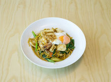 Fried noodles with sea food, vegetables and poached egg, thai fo Stock Images
