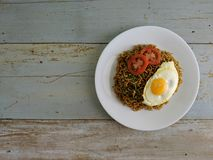 Fried noodles served with fried egg. Food flat lay concept. From top view on wood background royalty free stock photo