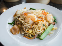 Fried noodles with shrimp and squid on white plate Royalty Free Stock Photo
