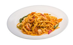 Fried noodles with shrimps. And vegetables isolated stock photography