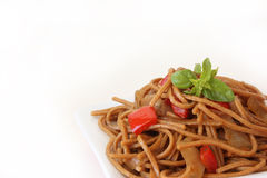 Fried noodles with vegetables and basil Stock Photo