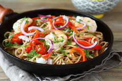 Fried noodles with vegetables and prawns Royalty Free Stock Image