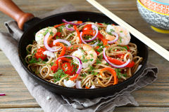 Fried noodles with vegetables and shrimp in a frying pan Royalty Free Stock Photography
