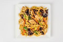Fried noodles on a white plate royalty free stock photo