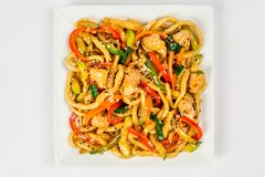 Fried noodles on a white plate stock images