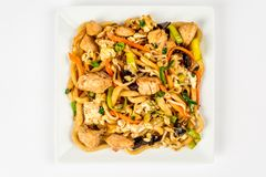 Fried noodles on a white plate royalty free stock images