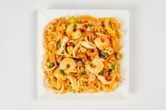 Fried noodles on a white plate stock photos