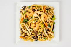Fried noodles on a white plate royalty free stock image