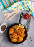 Fried nuggets of chicken breast with ketchup and spices Royalty Free Stock Image