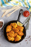 Fried nuggets of chicken breast with ketchup and spices Stock Image