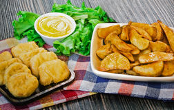 Fried nuggets and potato. Rustic Royalty Free Stock Photos