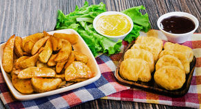Fried nuggets and potato rustic. Fried nuggets and fries at the village on the table Stock Photography