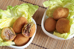Fried olives in white bowls royalty free stock photo