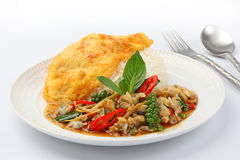 Fried omelet topped on rice with spicy fried with Clams Royalty Free Stock Photography