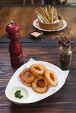 Fried onion. Onion rings fried ketchup food fries royalty free stock photography