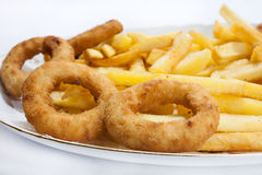 Fried onion ring with french fries in the plate Stock Photos