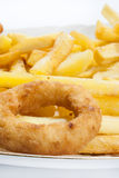 Fried onion ring with french fries in the plate Royalty Free Stock Photos