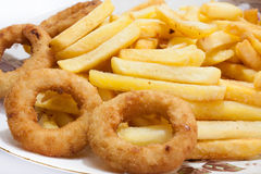 Fried onion ring with french fries in the plate Royalty Free Stock Image