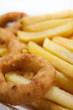 Fried onion ring with french fries in the plate Royalty Free Stock Photography