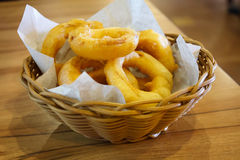 Fried onion rings. In basket Stock Photo