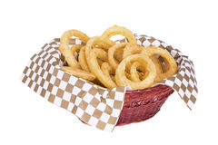 Fried onion rings. In basket, isolated on white background Stock Photos