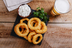 Fried onion rings in batter with sauce. Fried onion rings in batter Stock Photos