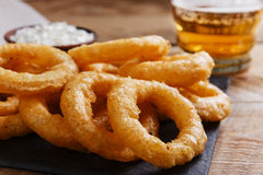 Fried onion rings in batter with sauce. Beer royalty free stock photos
