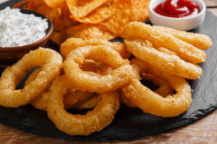 Fried onion rings in batter with sauce  chips Stock Photos