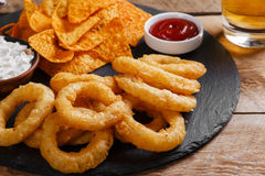 Fried onion rings in batter with sauce  chips Royalty Free Stock Images