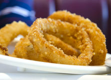Fried onion rings. Classic fast food side dish of fried onion rings Royalty Free Stock Photos