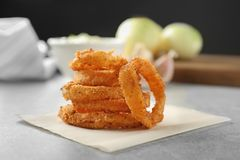 Fried onion rings. On table Royalty Free Stock Photo