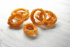 Fried onion rings. On wooden background Royalty Free Stock Photos