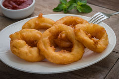 Fried onion rings with ketchup Royalty Free Stock Image
