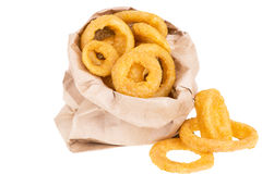 Fried onion rings. In paper bag, isolated on white background Royalty Free Stock Photo