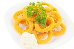 Fried onion rings, parsley and mayonnaise on a plate, white back Stock Photography