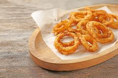 Fried onion rings. On wooden dish Royalty Free Stock Photos