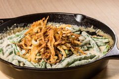 Fried onions with beans in a cast iron skillet Stock Images