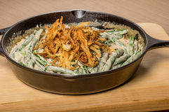 Fried onions with beans in a cast iron skillet Royalty Free Stock Images