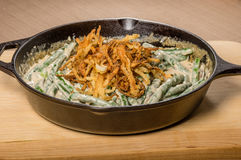 Fried onions with beans in a cast iron skillet Royalty Free Stock Image