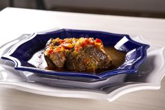 Fried ossobuco with vegetable ragout.  Royalty Free Stock Photos
