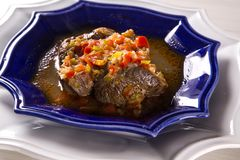 Fried ossobuco with vegetable ragout.  Royalty Free Stock Image