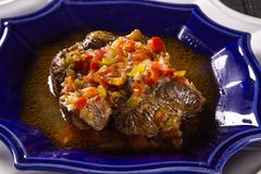 Fried ossobuco with vegetable ragout.  Royalty Free Stock Photography