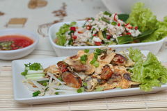 """Fried oyster with bean sprouts with chili sauce.Selective focus. Fried oyster with bean sprouts and shallot as """"Hoi Tod"""" in Thai served with chili sauce is Stock Photo"""